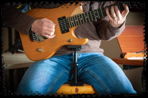 Playing electric guitar with Guitar Prop